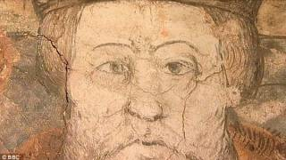Out with his head! Couple uncover medieval mural of King Henry VIII