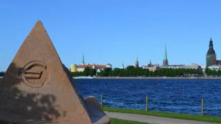 Against the wishes of its own people; Latvia reluctantly joins euro