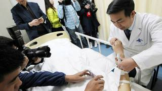 Chinese Doctor Grows Artificial Ear on Patient's Arm