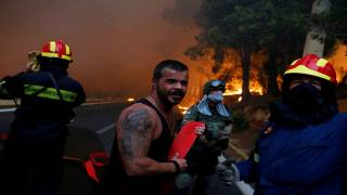 Arson Suspected as Greek Wildfires Devastate Resort Areas near Athens, Killing Scores